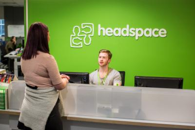 headspace receptionist greeting someone at office reception